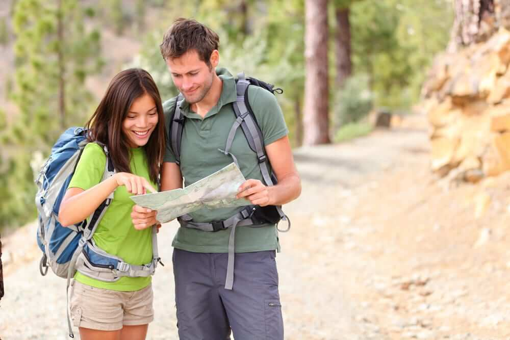 2 people on a hike looking at a map